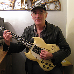 Barry Monks with Ollie's guitar